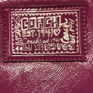 Purple coach clutch